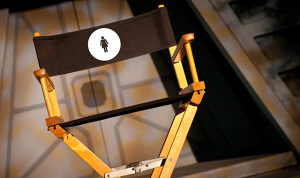 "Director's chair with a woman symbol. From ARTINFO's ""Twelve Female Directors That Are Reshaping American Theater"""
